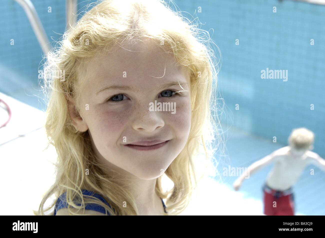 Pool empty children ball-games girls blond portrait series people blond gaze camera smiles naturalness boys bath - Stock Image