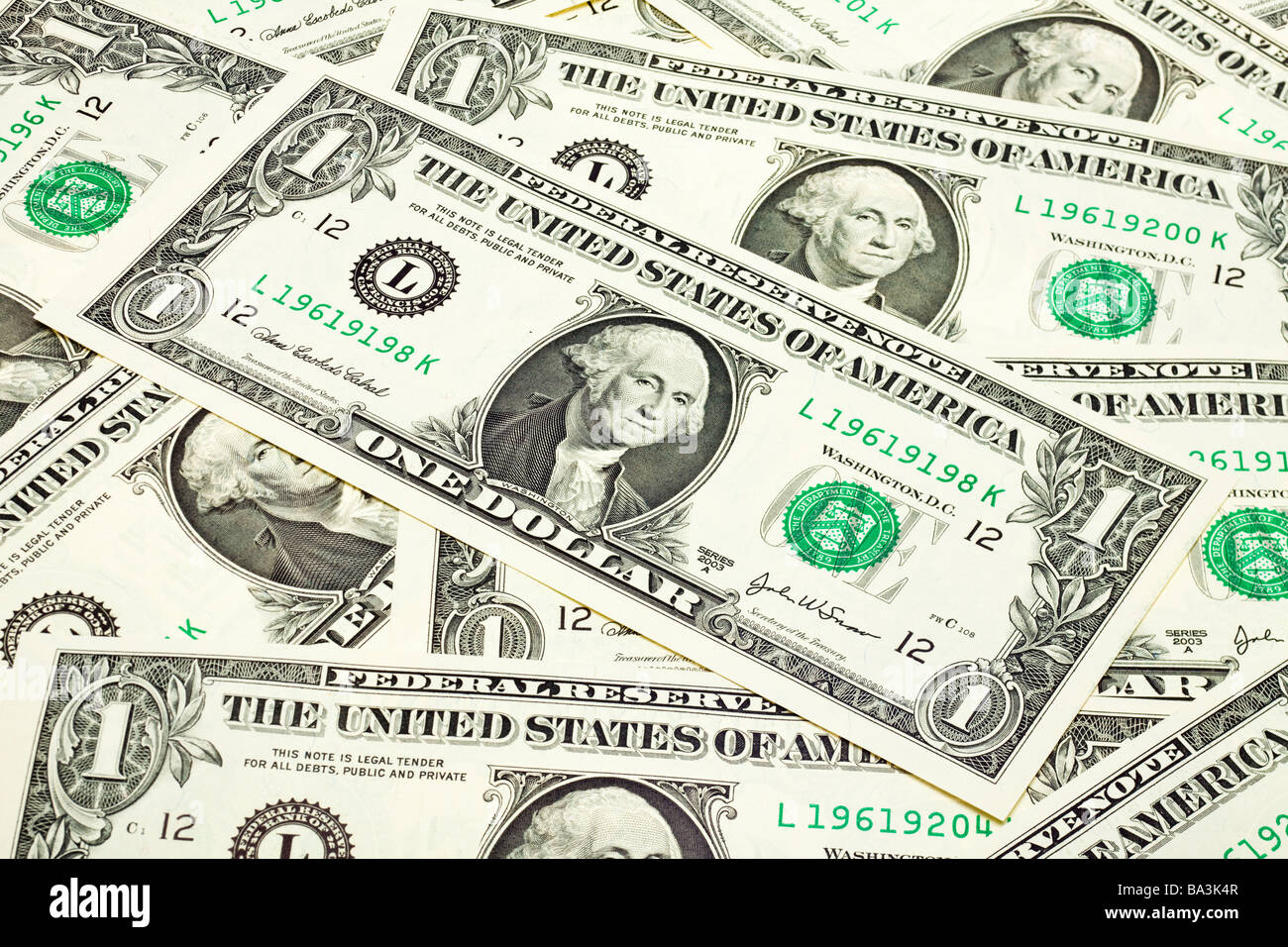 Group of US One Dollar bills laid flat close up - Stock Image