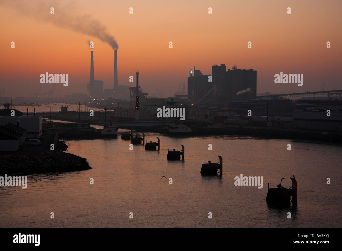 View of Le Havre port from the sea just before sunrise - Stock Image