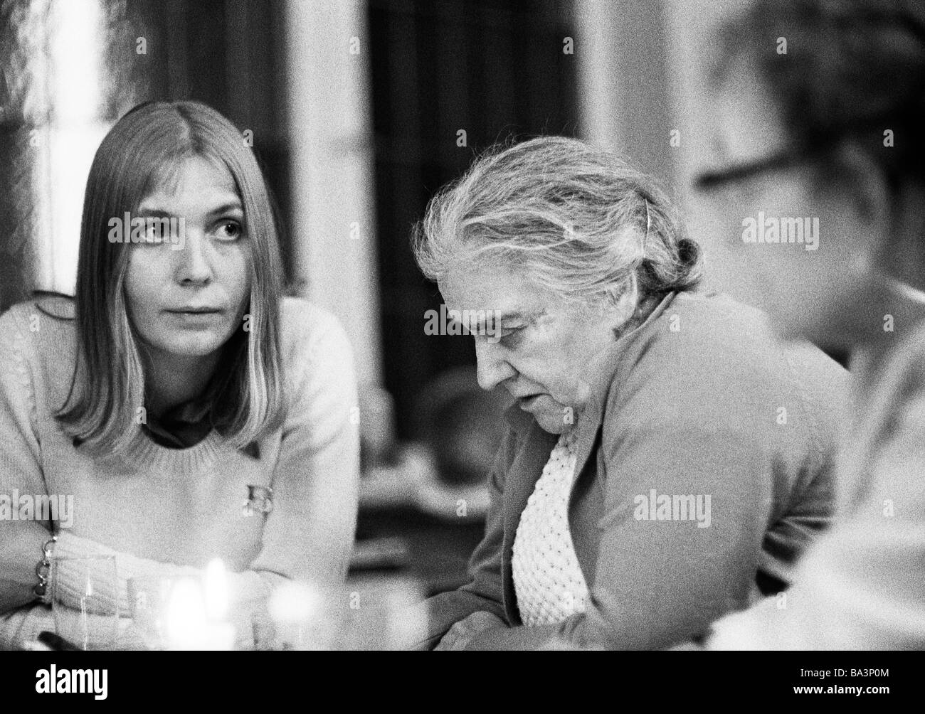 Seventies, black and white photo, people, young woman and older woman sit together, sadness, depressions, aged 25 - Stock Image