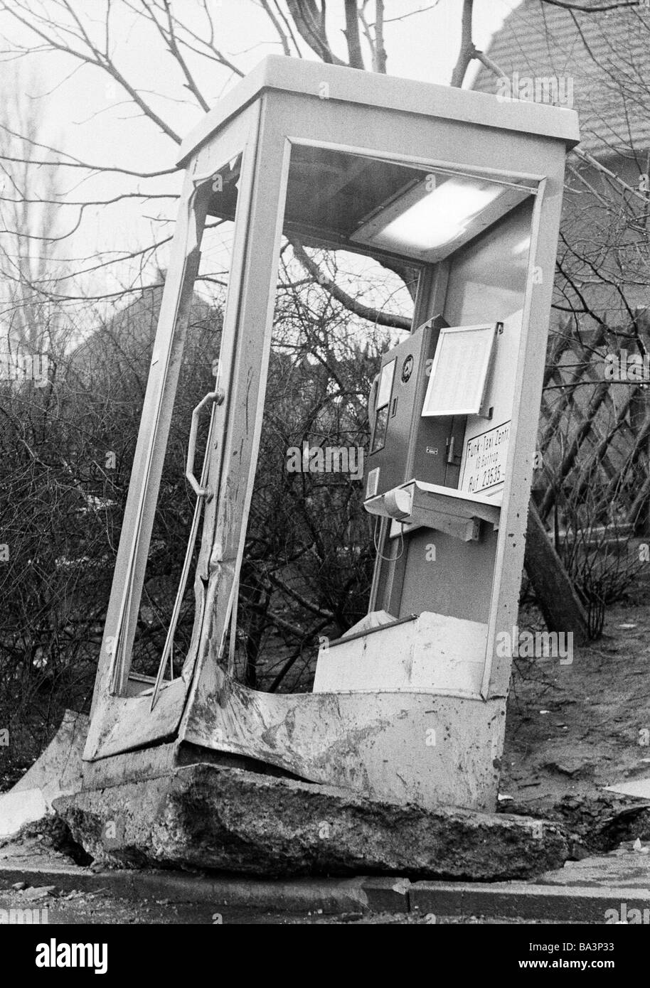 Seventies, black and white photo, destruction, vandalism, telephone box was destroyed and pulled out of the ground - Stock Image