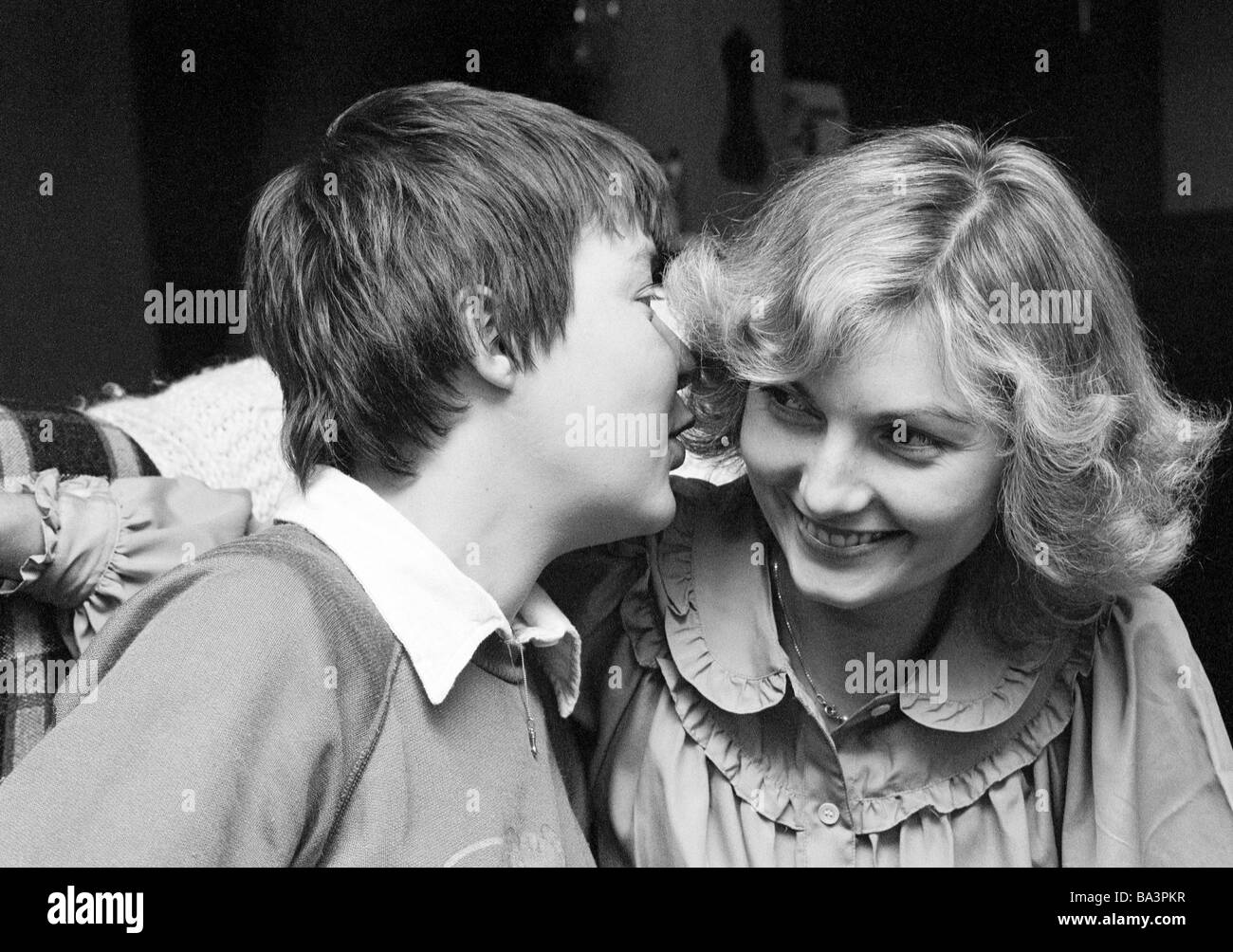 Seventies, black and white photo, people, two young women, whispering, portrait, aged 25 to 30 years, Monika, Jutta - Stock Image