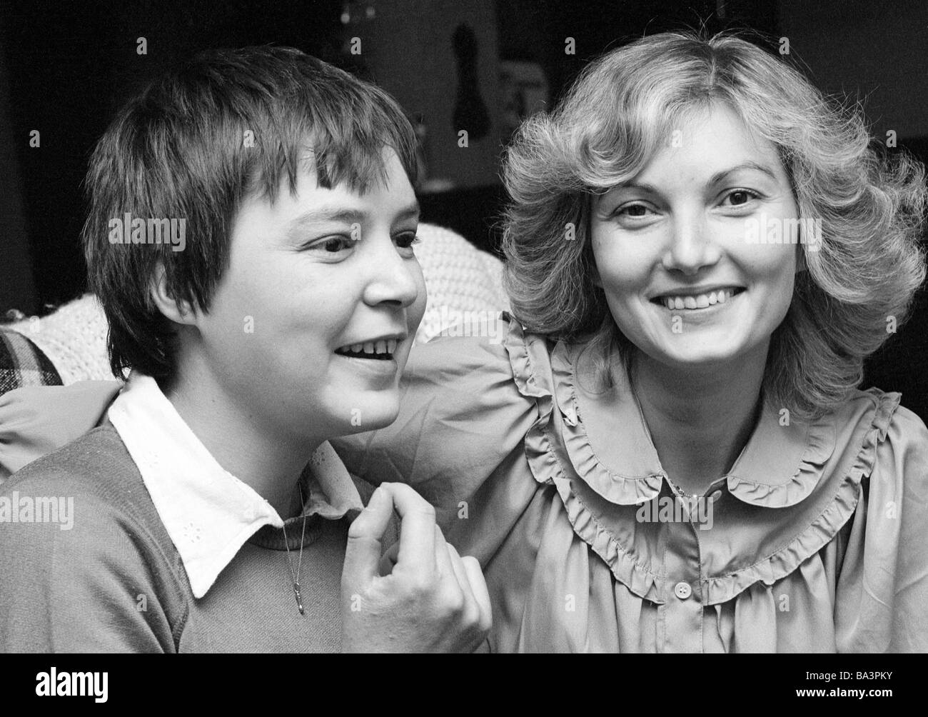Seventies, black and white photo, people, two young women, laughing, portrait, aged 25 to 30 years, Monika, Jutta - Stock Image