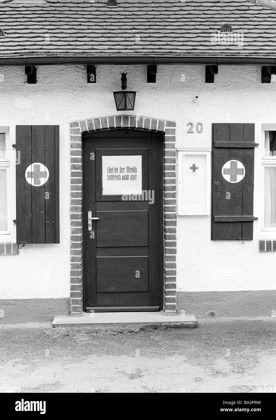 Eighties, black and white photo, aid organization, front door, shutters, entry area of a DRK station, German Red - Stock Image