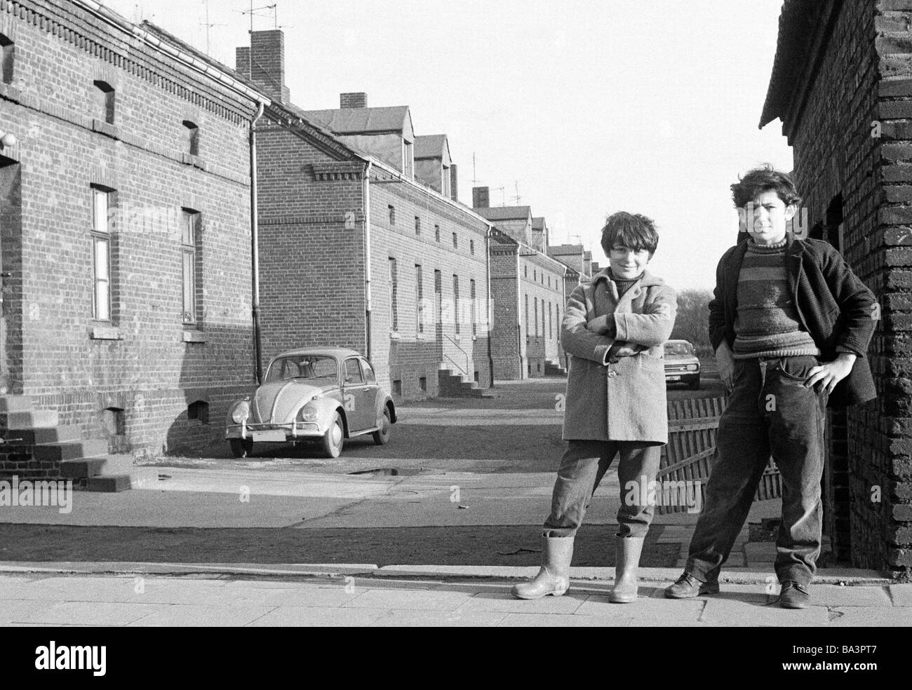Seventies, black and white photo, people, children, two boys posing at a housing estate, pithead buildings, colony - Stock Image
