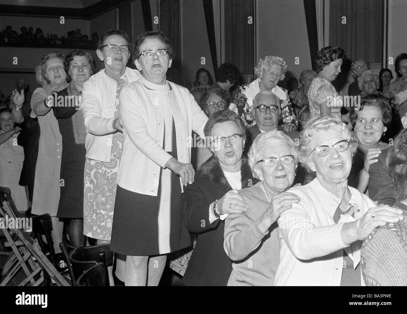Seventies, black and white photo, people, freetime, carnival for older people, seniors ball, older women and men - Stock Image