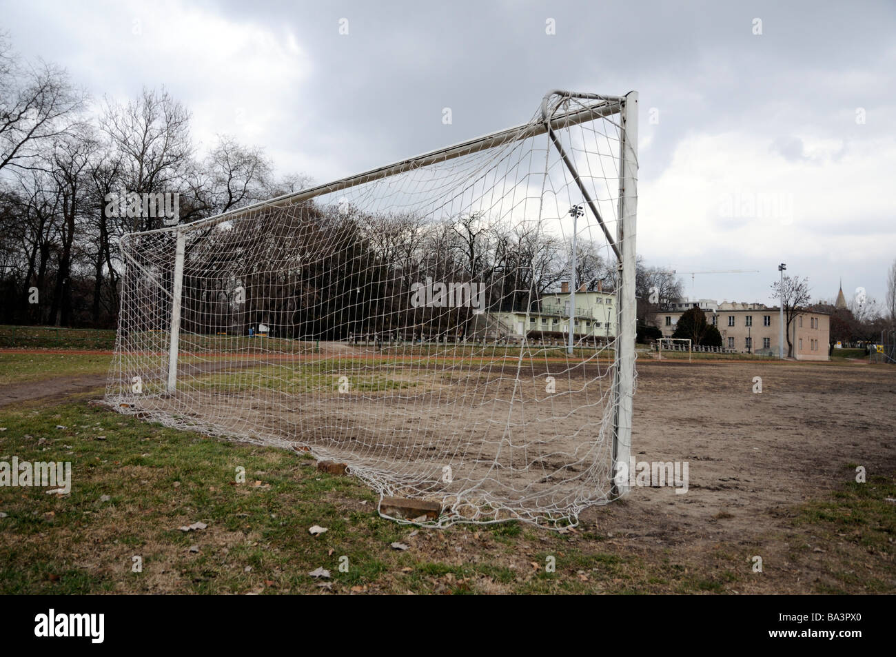 Football pitch in deserted sports ground, Budapest, Hungary. - Stock Image