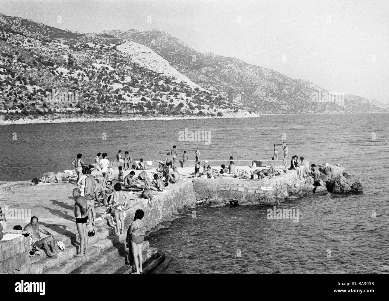 Seventies, black and white photo, holidays, tourism, bathing tourists, people take a sunbath, Croatia, at that time - Stock Image
