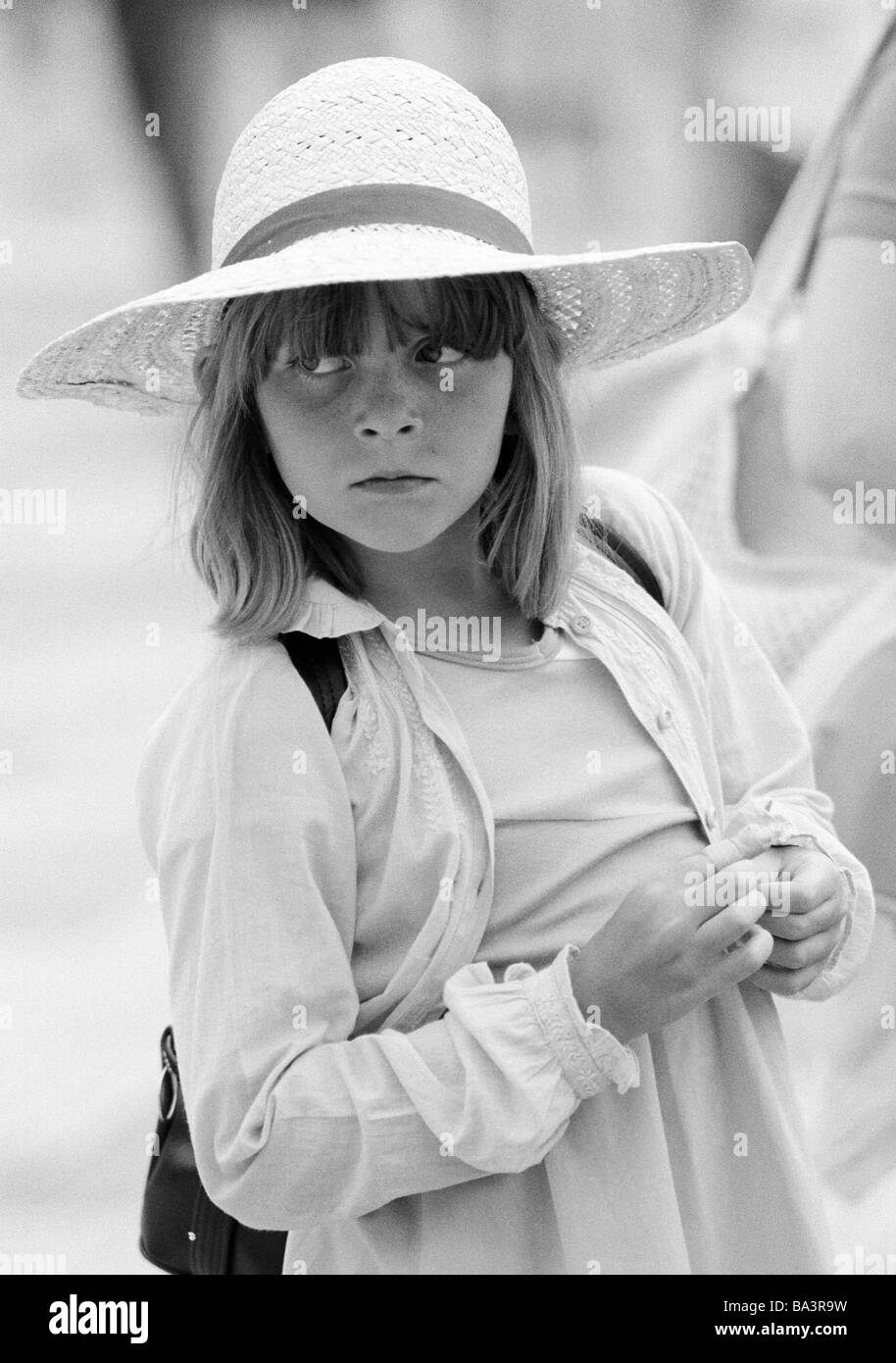 Eighties, black and white photo, people, children, little girl wearing a strawhat, portrait, aged 7 to 10 years, - Stock Image