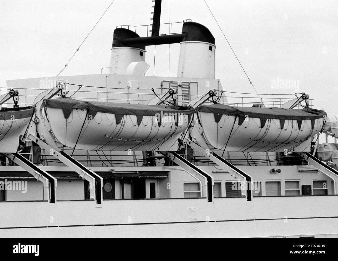 Eighties, black and white photo, travel, holidays, safety, lifeboats on an ocean liner, seaport of Santa Cruz, Spain, - Stock Image