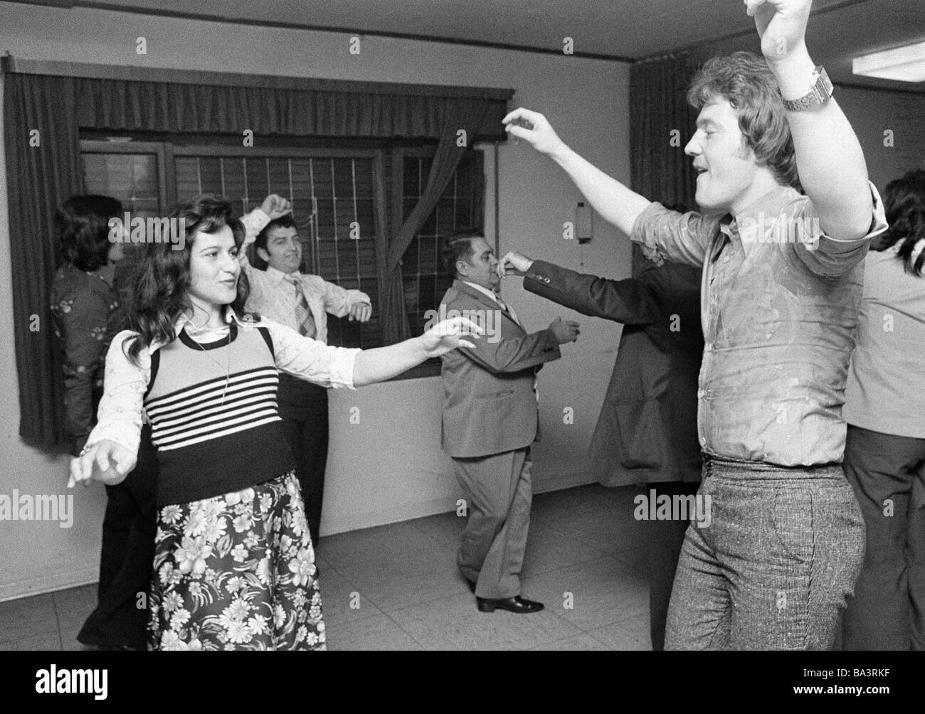 Seventies, black and white photo, people, minorities, guest-workers in Germany, Greeks, dance event, man, aged 25 - Stock Image