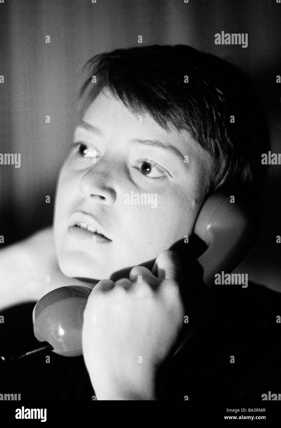 Seventies, black and white photo, people, young girl, portrait, aged 20 to 25 years, telephone, earphone, Monika - Stock Image