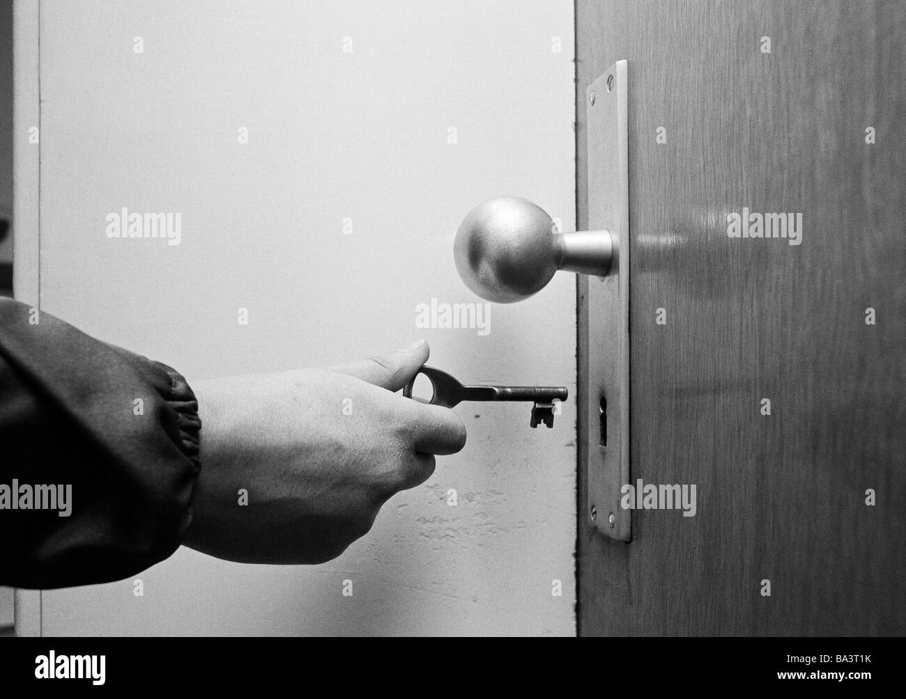 door lock and key black and white. Contemporary And Seventies Black And White Photo Symbolic Safety Open Up An Apartment  Door Hand Holding A Key Doorknob With Door Lock And Key Black White