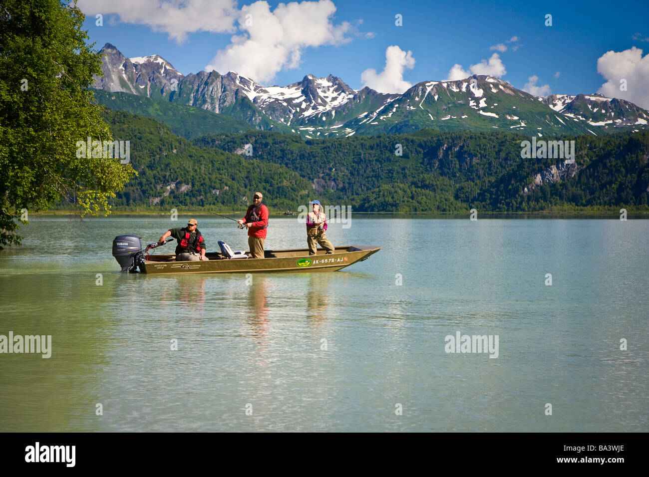 Anglers spin fish from a boat in Big River Lakes in Redoubt Bay, Southcentral Alaska during Summer Stock Photo