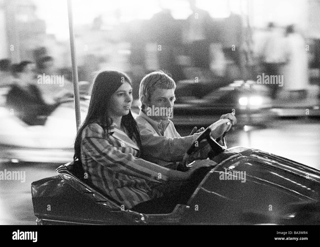 Seventies, black and white photo, people, young couple in a dodgem car, kermess, aged 20 to 25 years, Crange Kermess, - Stock Image