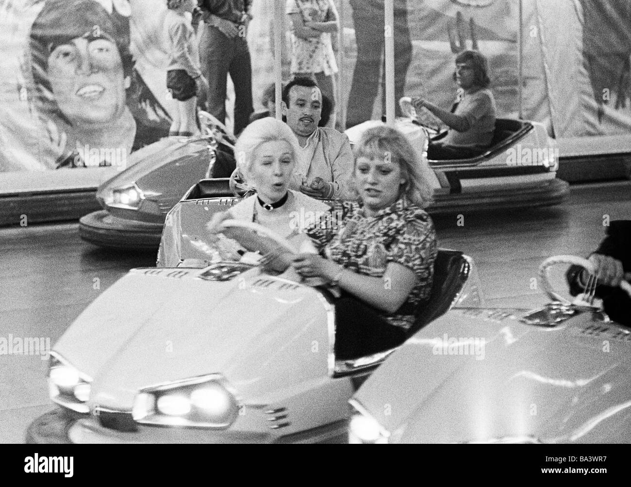 Seventies, black and white photo, people, two women in a dodgem car, kermess, aged 30 to 40 years, 50 to 60 years, - Stock Image