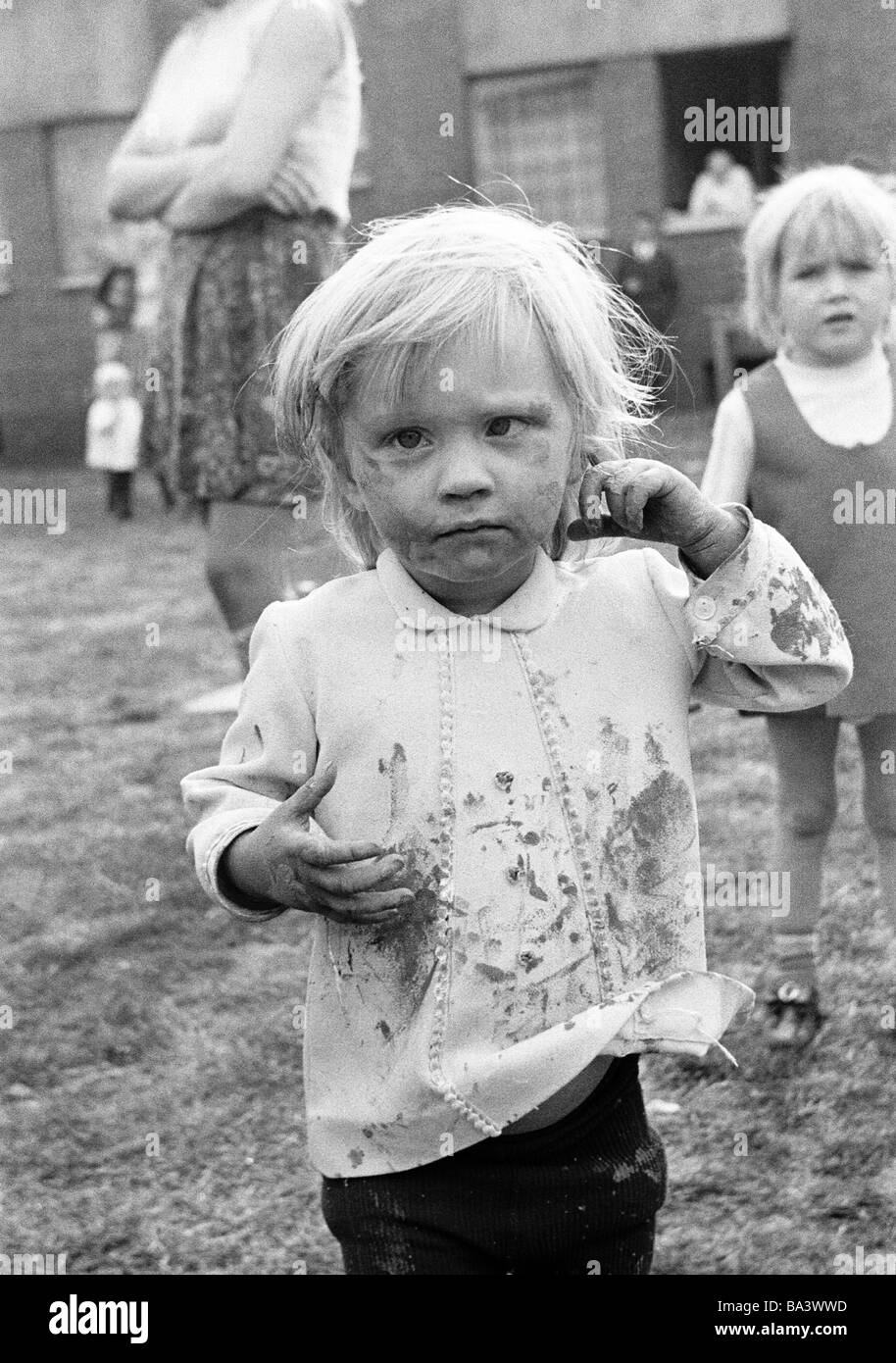 Seventies, black and white photo, people, children, little girl, portrait, street kid, dirty, unkemptly, aged 4 Stock Photo