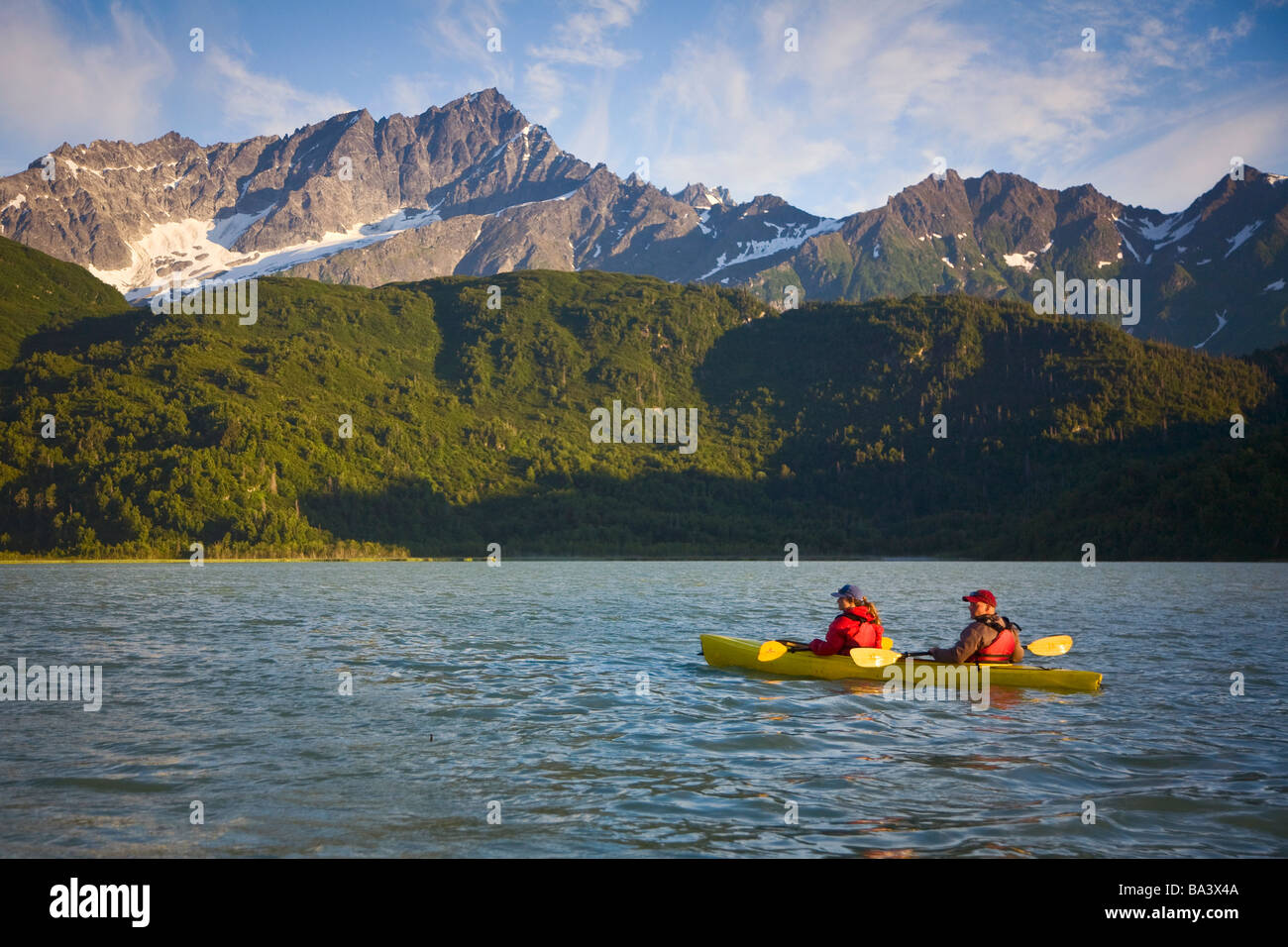 Kayakers on Big River Lakes with Chigmit Mountains in the background during Summer in Southcentral Alaska - Stock Image