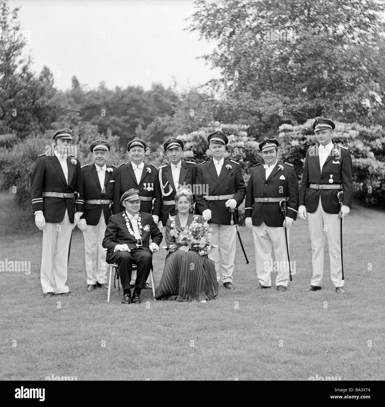 Seventies, black and white photo, people, shooting match, posing members of a shooting association, shooting uniform - Stock Image