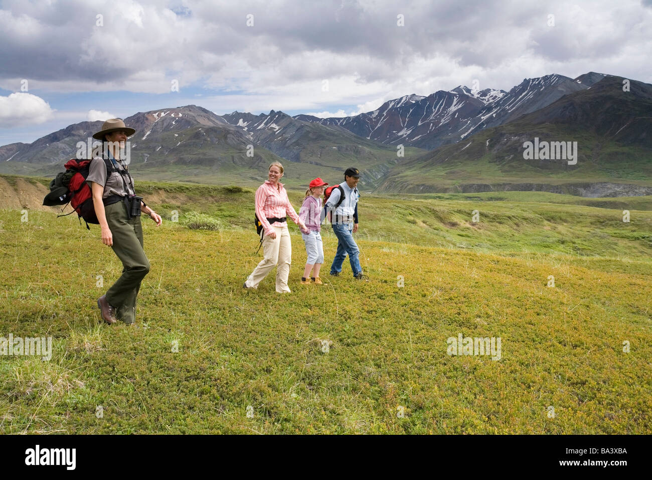 Female National Park Interpretive Ranger leads group on a *discovery hike* in the Eielson area Denali National Park Stock Photo