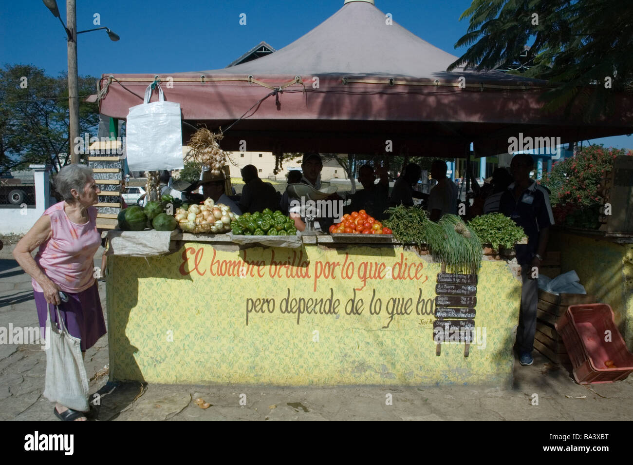 CUBA Santiago de Cuba Market stall with quotation from Jose Marti 'A man shines for what he says but it depends - Stock Image