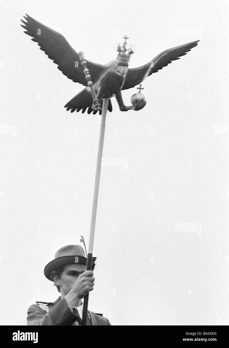 Seventies, black and white photo, people, shooting match, gunman carries a Popinjay on a rod to the bird shooting - Stock Image