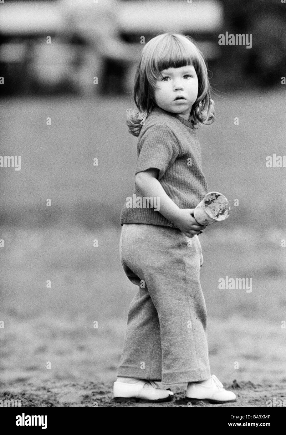 Seventies, black and white photo, people, children, little girl, aged 2 to 3 years Stock Photo