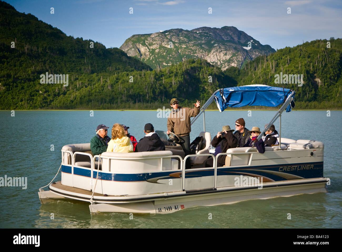 Guests of Redoubt Bay Lodge view Chigmit Mountains and scenery from pontoon boat on Big River Lakes, Southcentral, - Stock Image