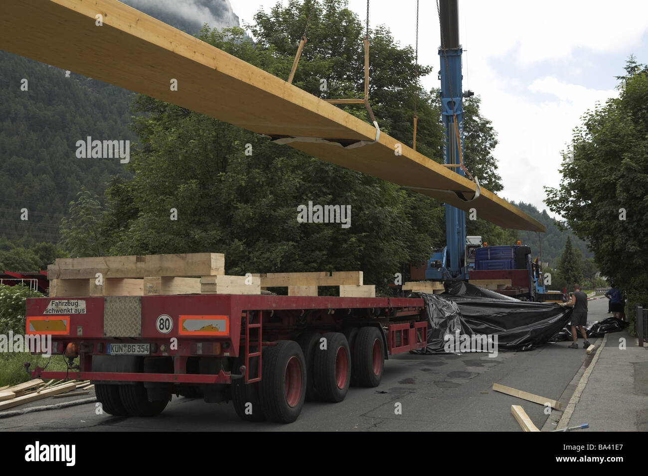 Elegant Street Truck Crane Arm Wood Bearers Man Lifts Back Opinion Building Site  Construction Works House Construction Construction