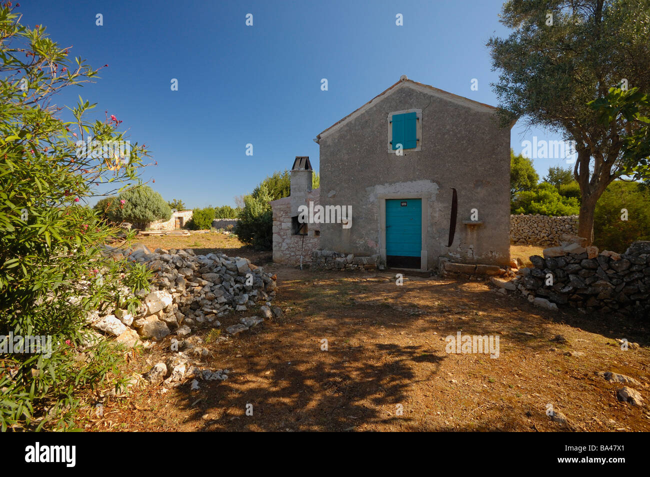 Typical Mediterranean house and courtyard on island Cres, Croatia, Europe - Stock Image