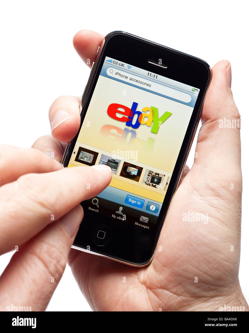Male hands using iPhone and using the Ebay app on a smartphone smart phone mobile phone - Stock Image