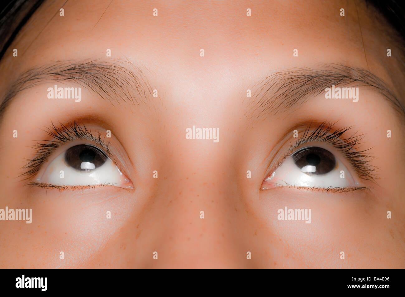 Black or dark brown eyes - Stock Image