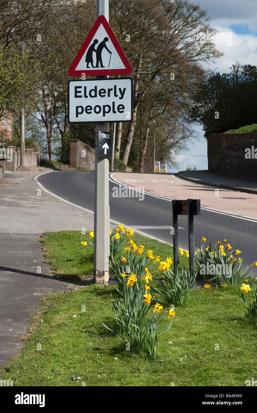 """Roadsign warning about """"Elderly People"""" Stock Photo"""