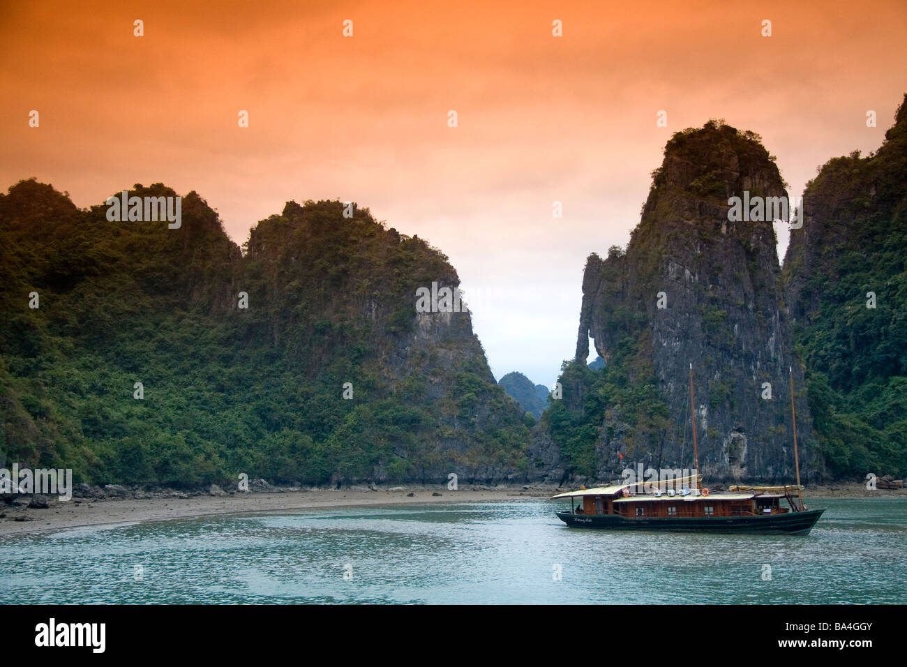 Scenic views of limestone karsts and tourist boats in Ha Long Bay Vietnam Stock Photo