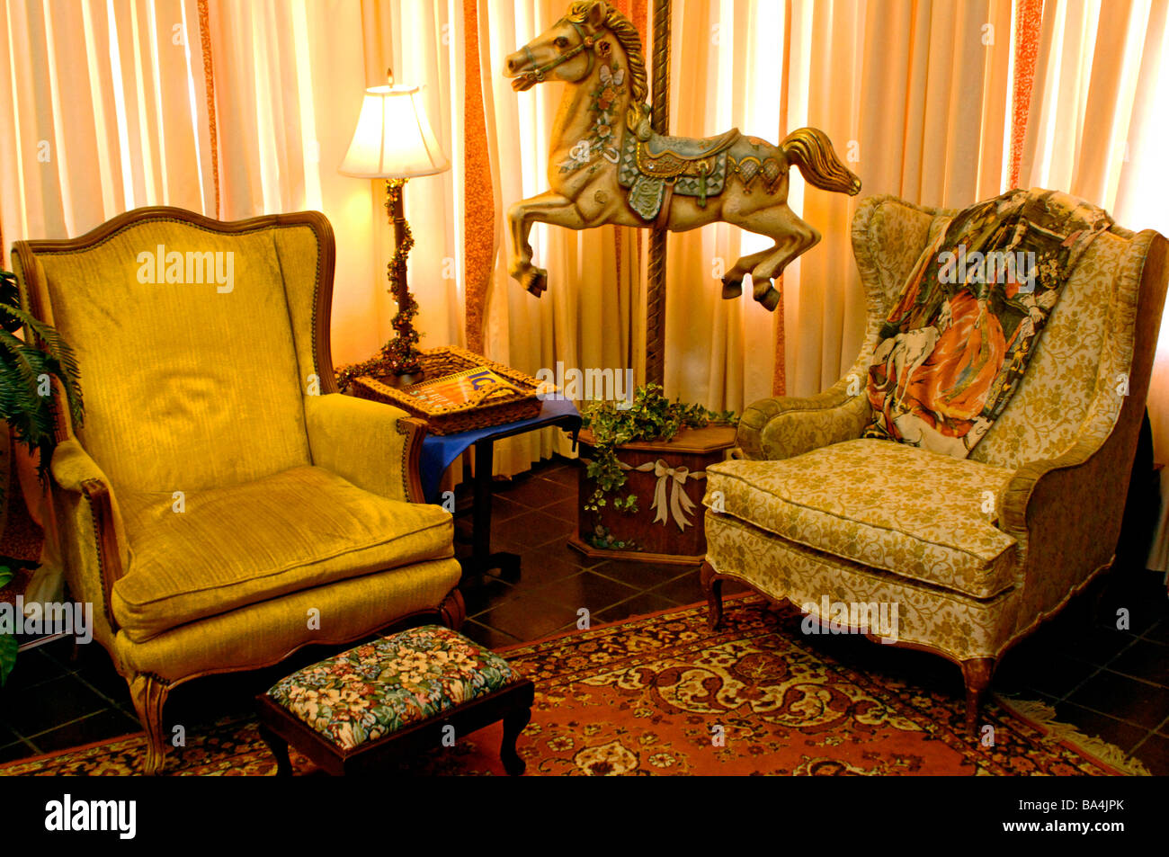 Seventies interior decorating complete with carousel horse Stock ...