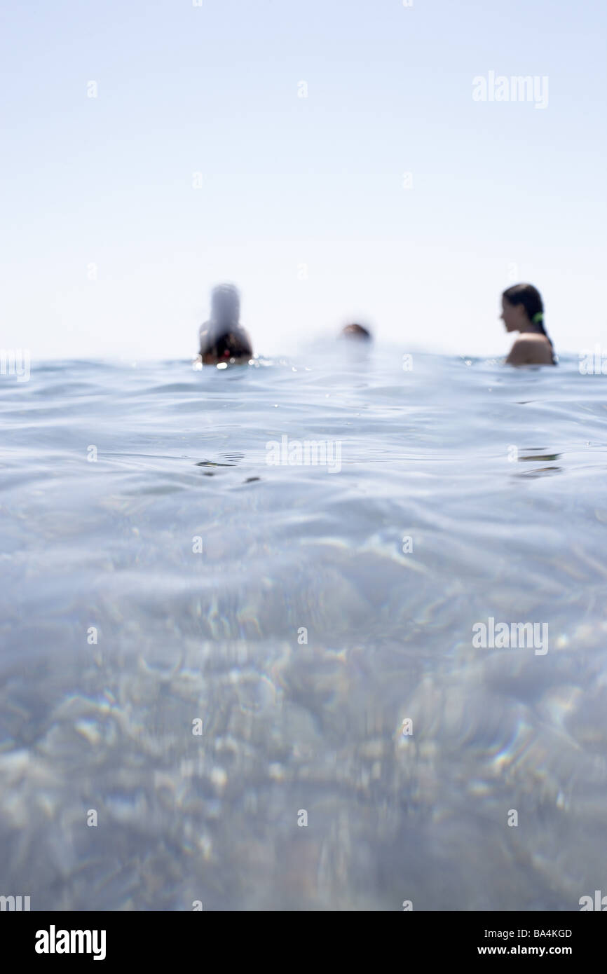 Sea people water stands detail people bath-fun refreshment cooling splashes swims enjoyments leisure time vacation - Stock Image