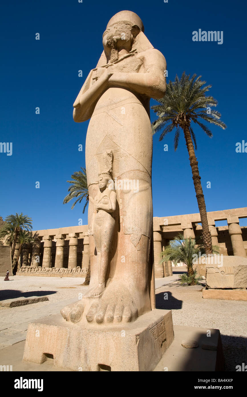 Colossal statues of Ramesses II close to the Second Pylon at Karnak Temple, Luxor Egypt - Stock Image