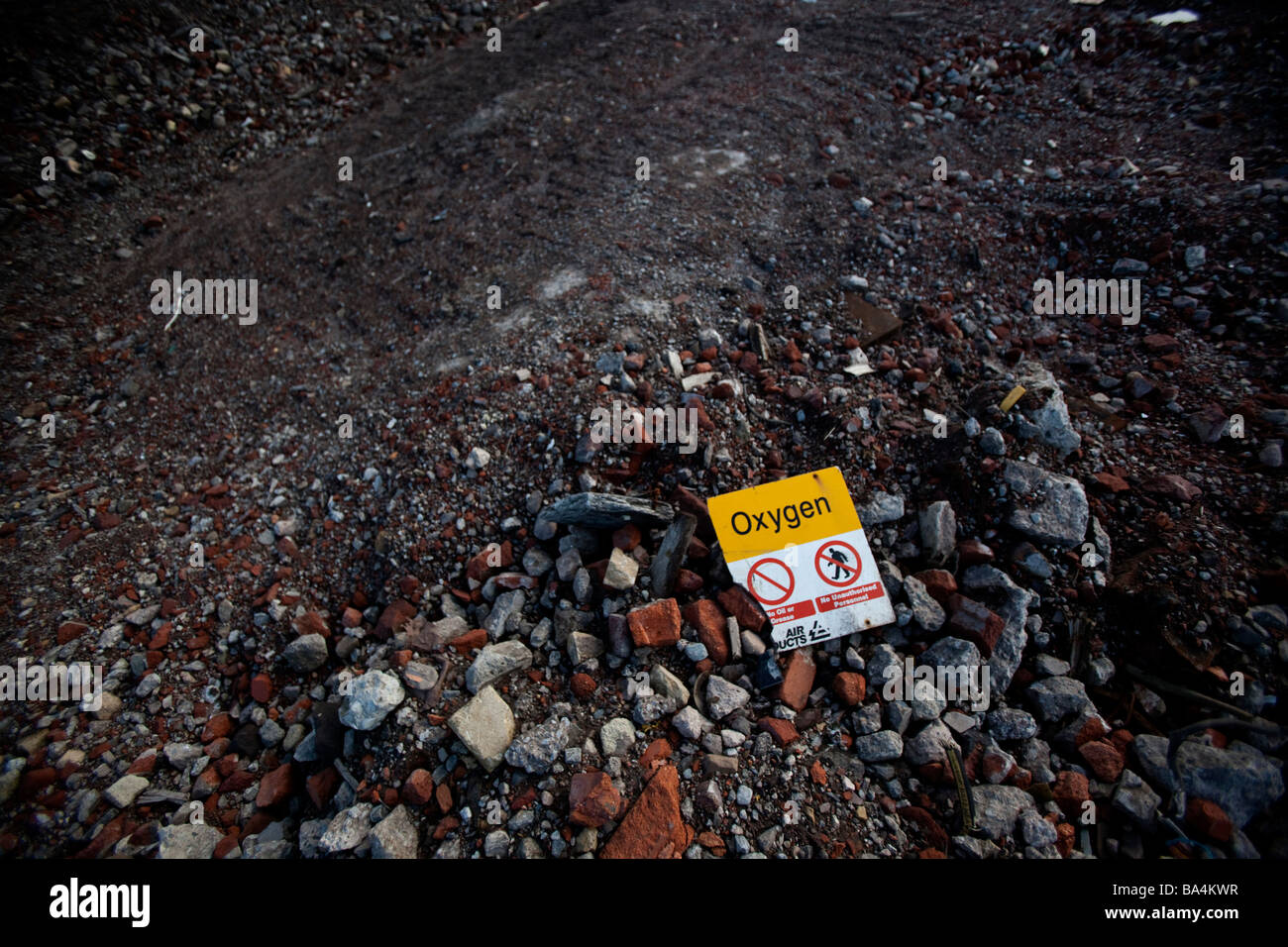A oxygen warning sign in building rubble on a disused factory site - Stock Image