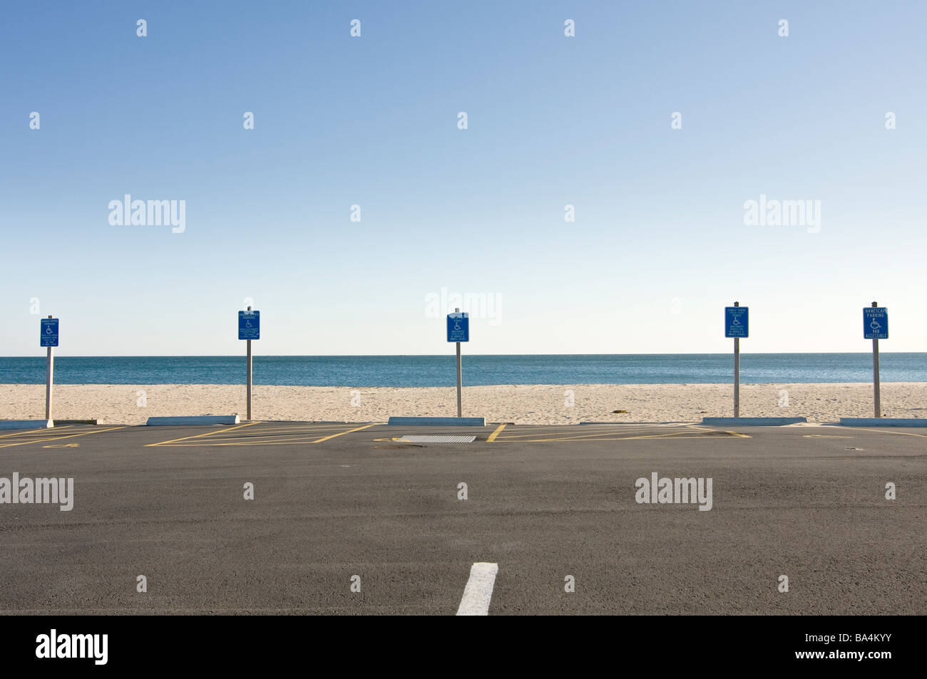 Handicap parking signs and parking spaces at beach - Stock Image