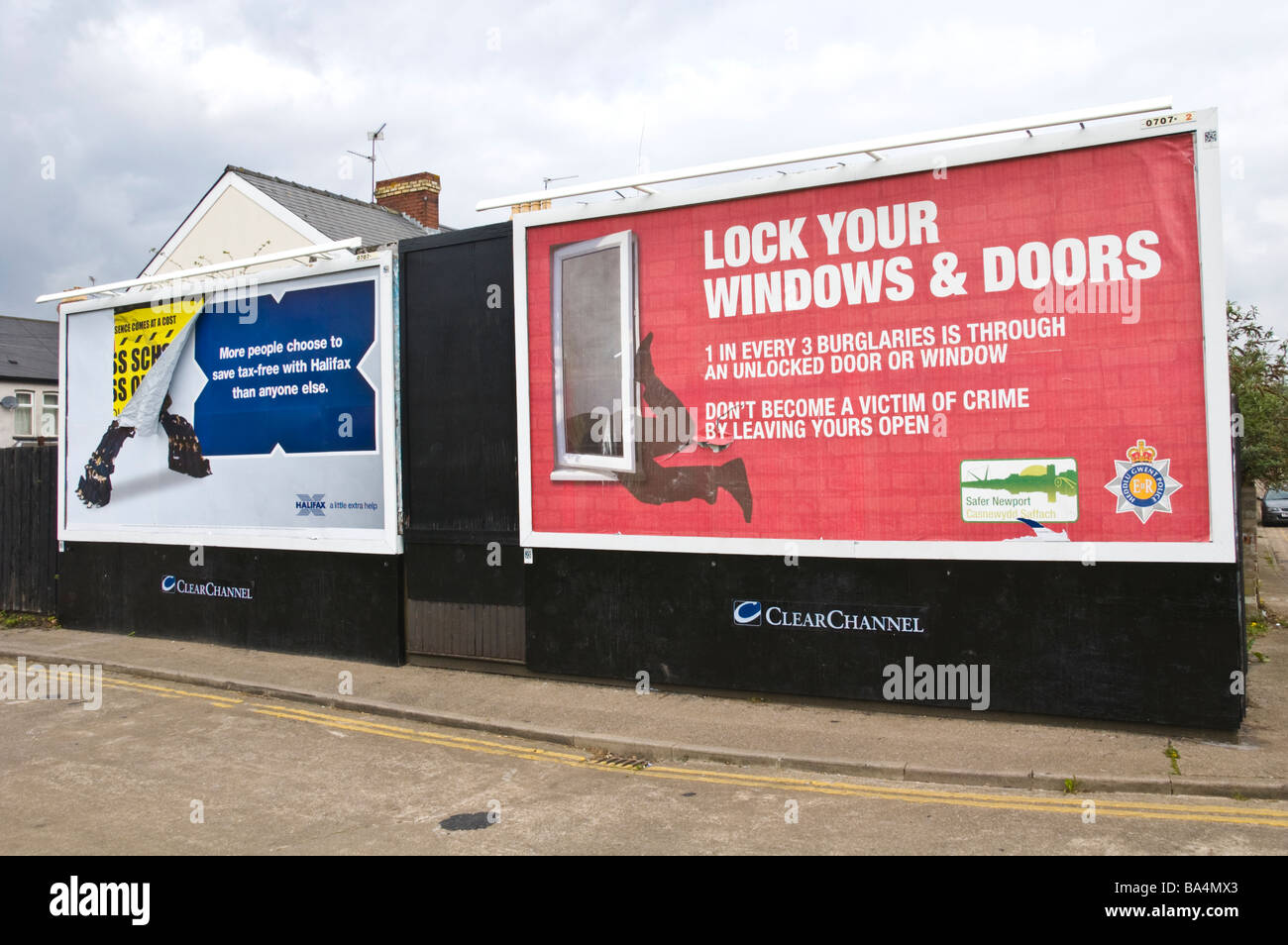 ClearChannel advertising billboards for Halifax bank and crime prevention imitative on hoardings in Newport South - Stock Image
