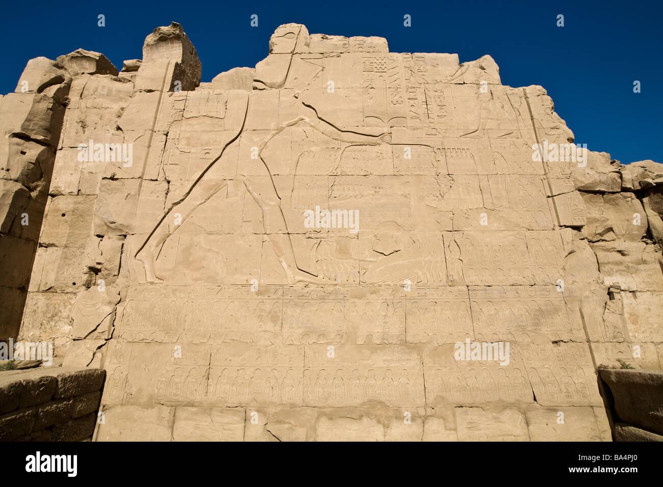 Relief of Pharaoh smiting his enemies at Karnak Temple, Luxor Egypt - Stock Image