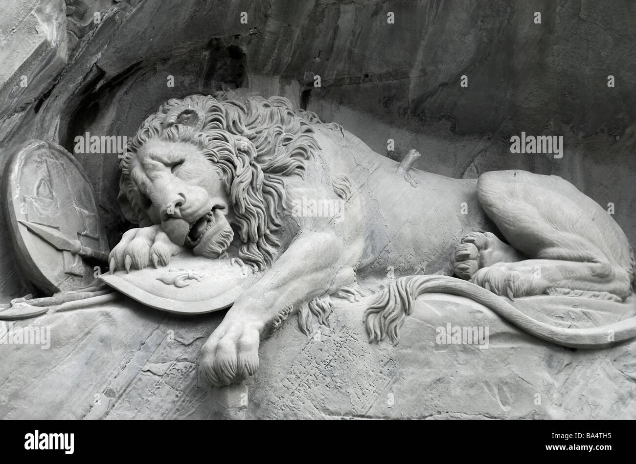 The Lion Monument (German Löwendenkmal) or the Lion of Lucerne is a sculpture in Lucerne, Switzerland - Stock Image