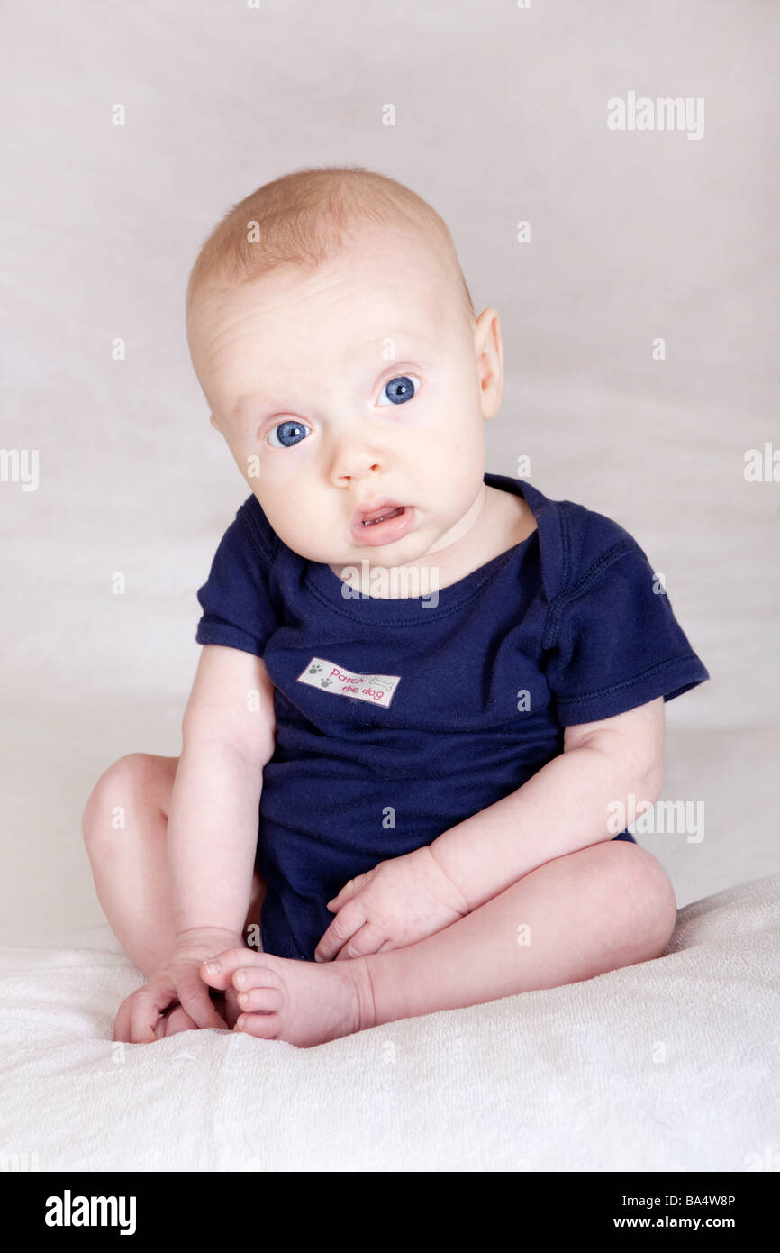 ad21fa002741 Three month old newborn baby boy sitting upright playing with feet cute  gorgeous angelic innocent wide