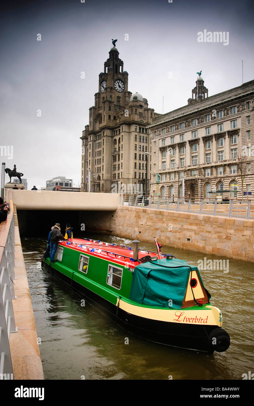The narrowboat  named Liverbird on the new canal link on the Leeds Liverpool in front of the Liver building - Stock Image