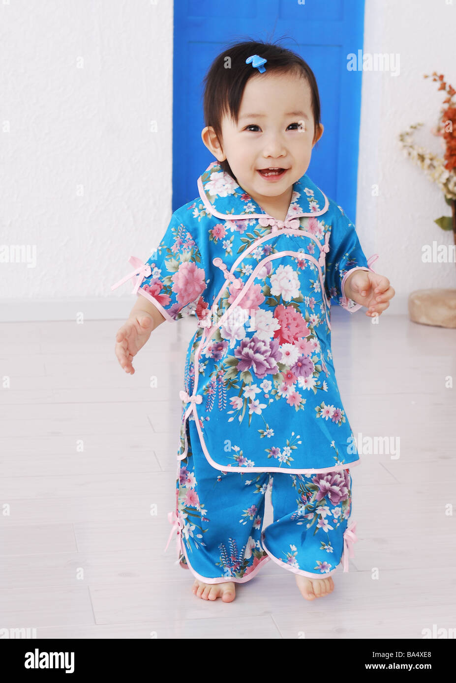 cd994bbe6954 Cute Chinese baby girl in traditional dress Stock Photo  23465520 ...