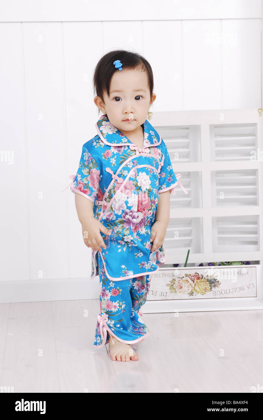 6d2dcf1d4867 Cute Chinese baby girl in traditional dress Stock Photo  23465544 ...