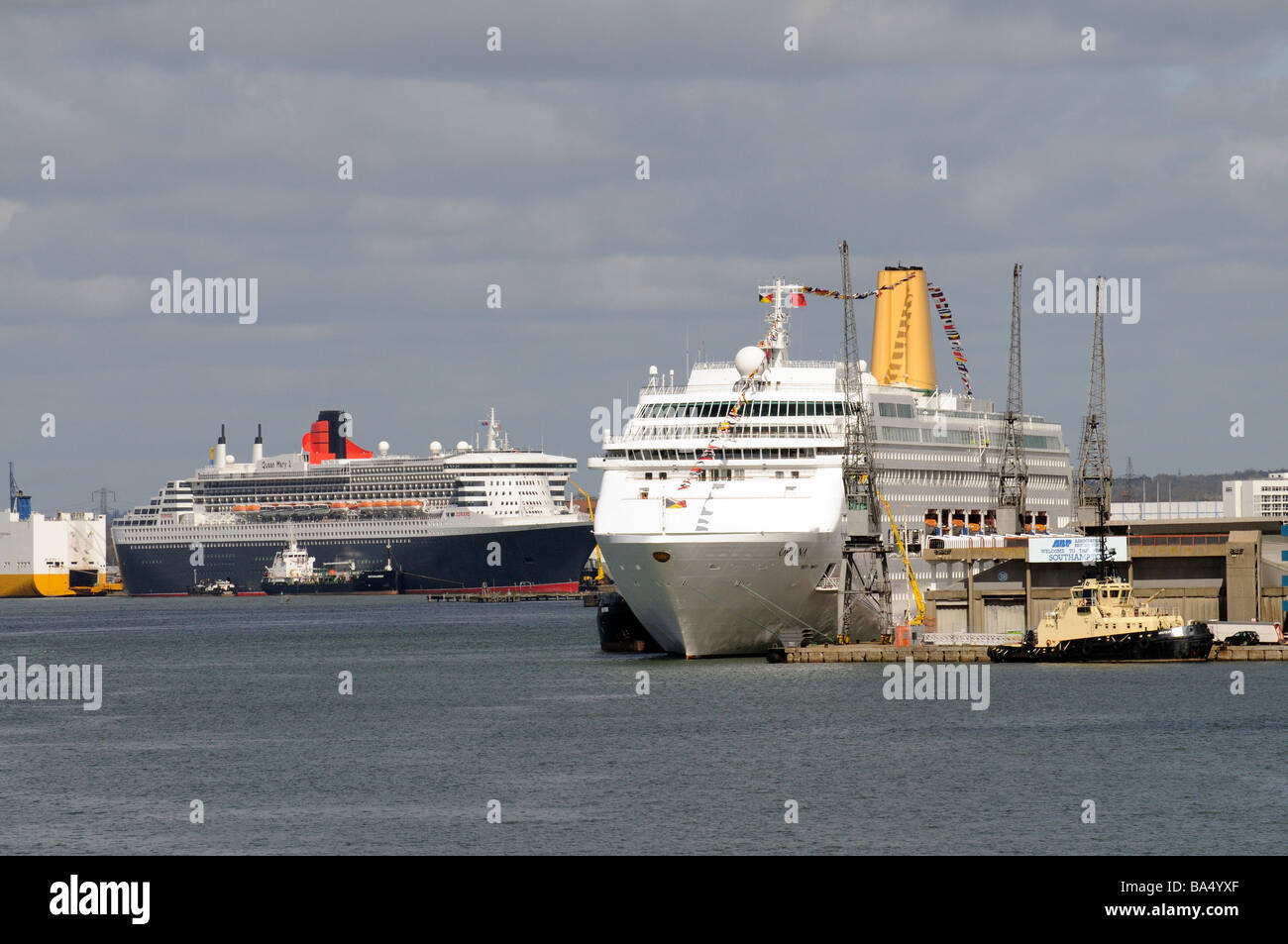 Southampton Docks England UK the Queen Mary 2 and the Oriana cruise ships berthed alongside - Stock Image