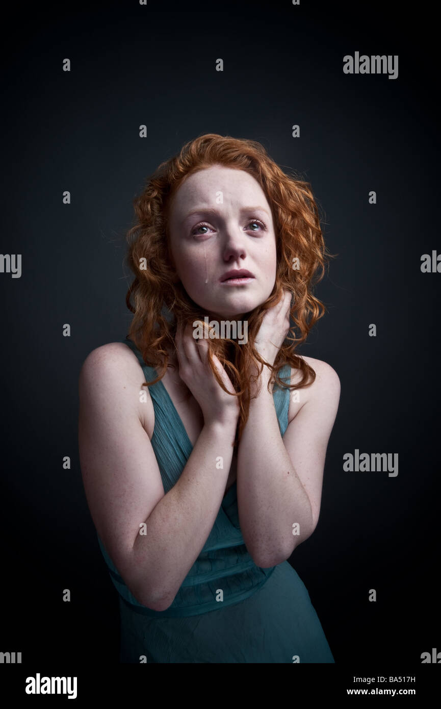 sad red haired woman girl crying alone - Stock Image