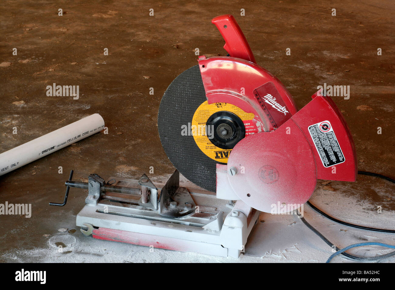 Abrasive disk chop saw for cutting PVC pipe on plumbing installation & Abrasive disk chop saw for cutting PVC pipe on plumbing installation ...