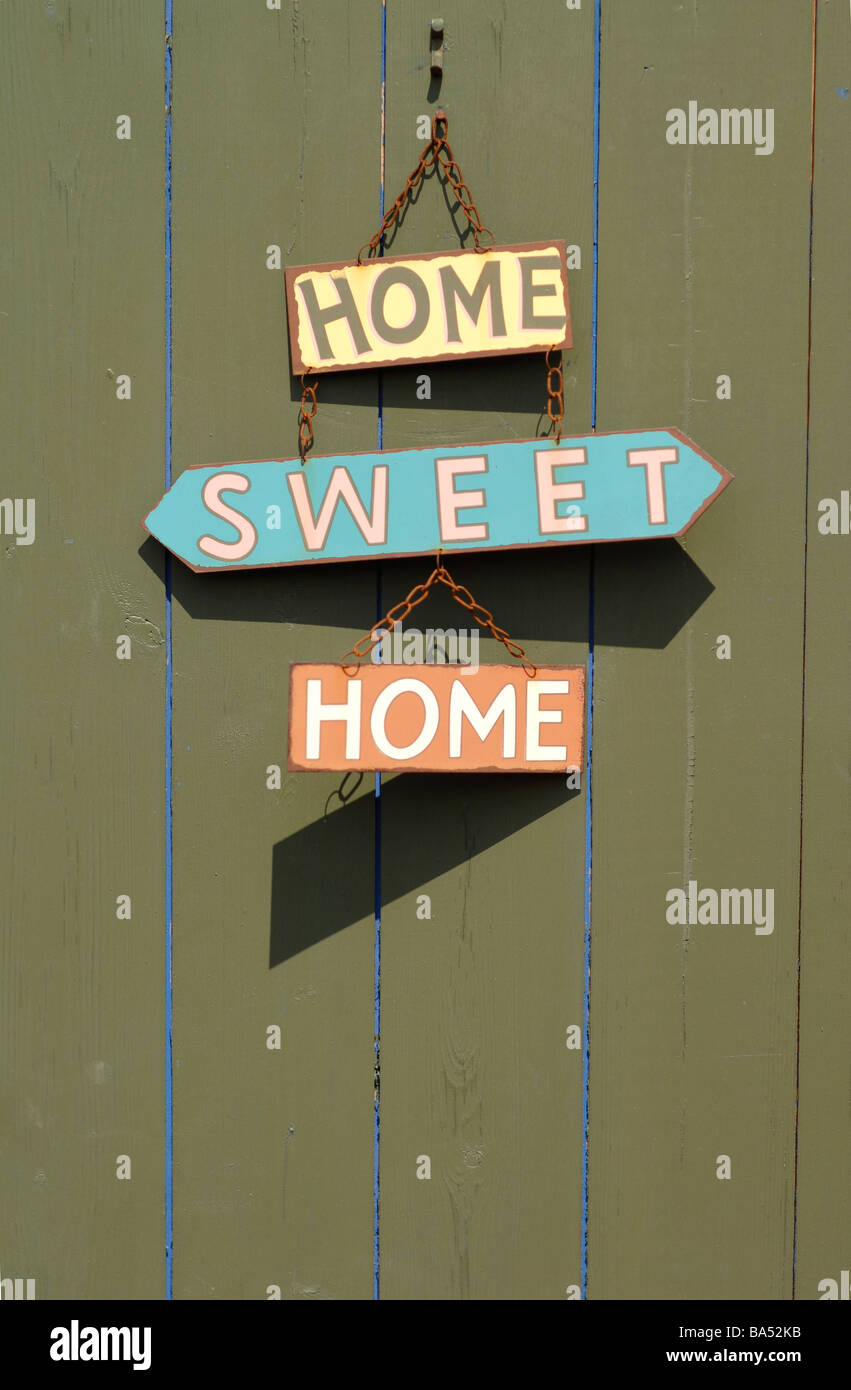Home Sweet Home sign hanging on a door - Stock Image